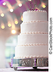 wedding cake with purple and lights in the background