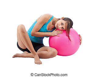 Girl with fitness ball, isolated in white