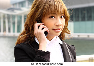 beautiful business woman on the phone at modern building