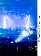 Music mixer desk - Music mixer desk, blurred crowd on the...