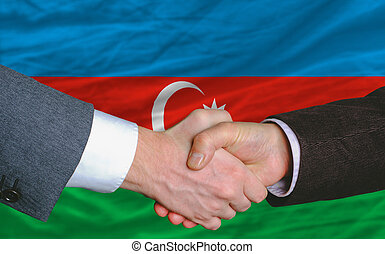 businessmen handshake after good deal in front of azerbaijan...
