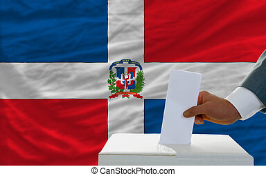man voting on elections in dominican republic in front of...