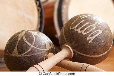 Cuban Maracas - Cuban maracas, backlit, bongos in...