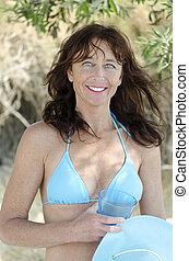 A happy smiling woman in bikini