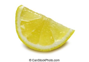 Juicy Lemon Wedge - Lemon wedge isolated on white