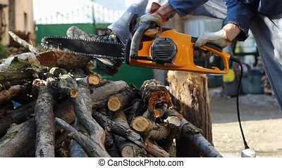 Electric chainsaw in action