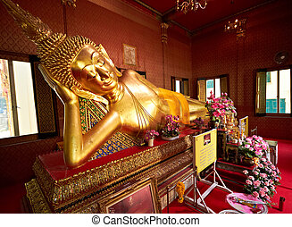 Reclining golen Buddha in temple of Bangkok, Thailand
