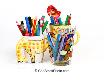 pen holders  with colored pens on a white background