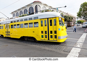 Streetcar - Yellow San Francisco Light Rail streetcar near...