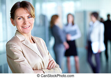 White collar worker - Image of smiling middle aged...