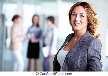 Happy leader - Image of pretty business leader looking at...