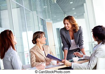 Working together - Image of four successful businesswomen...
