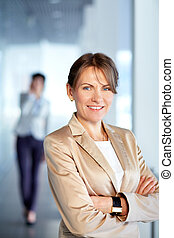Business leader - Image of successful businesswoman looking...