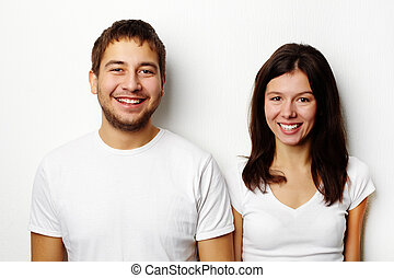 Couple in white T-shirts - Happy girlfriend and boyfriend in...
