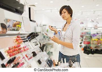 Girl at cosmetics  shop