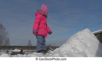 little girl on the snowdrift - indulges in a little girl in...
