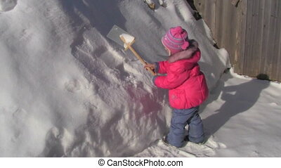 little girl with a shovel