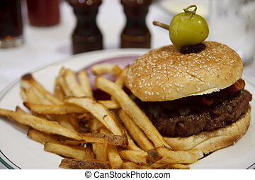Hamburger and Fries Garnished with Pepper - A gourmet...