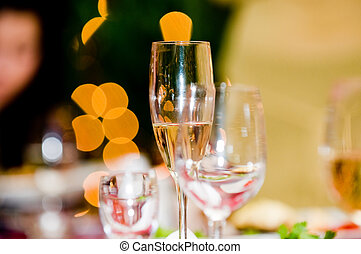 Wine glass over blurry holiday background