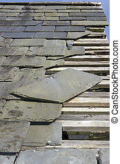 storm damaged roof with missing slates - broken and fallen...