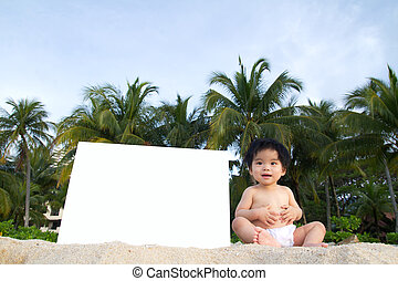 Beach baby - Little baby sitting on beach with a white blank...