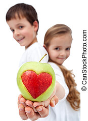 Happy healthy kids holding apple - Happy kids holding apple...