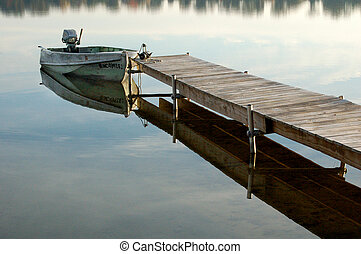 Boat At End of Wooden Dock