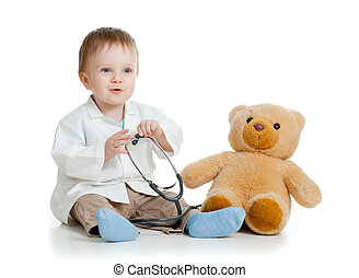 Adorable boy with clothes of doctor and teddy bear over white
