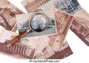 Pile of old cards with a magnifier