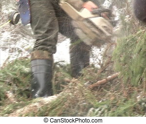 woodcutter chain saw cut - Uniformed woodcutters cut snow...