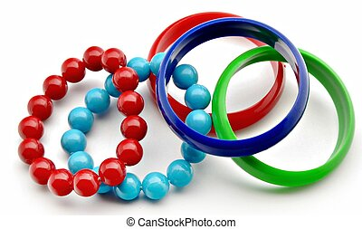 Bracelets of various colors surrounded by white background