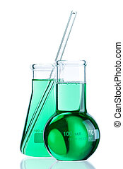 Laboratory glassware with colorful liquids on white...