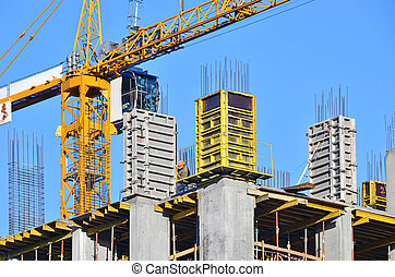 Concrete formwork and crane on construction site
