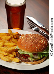 Burger and fries at a Pub - Photo of a burger with fries and...
