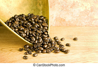 coffee beans in brass scoop