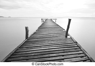 lonely - balck and white picture of old bridge to the sea