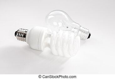 Tungsten and energy saving lightbulb on white background