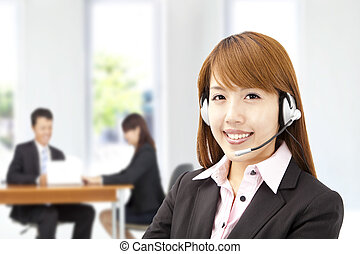 Smiling asian businesswoman  customer service on the phone