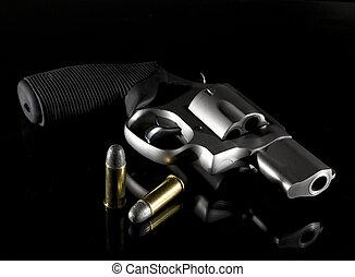 Dark handgun - Revolver that is on a glass nightstand with...