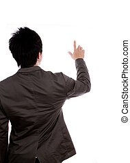 Back view of a young business man pointing
