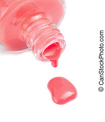 Pretty Coral Pink Nail Polish - Closeup of an open bottle of...