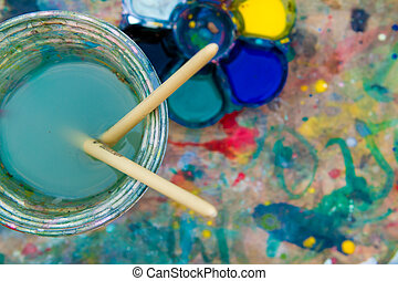 Paint buckets on grunge paint background