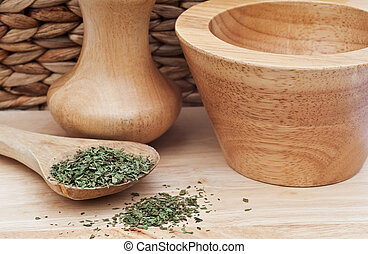 Chopped tarragon in rustic kitchen setting with wooden...