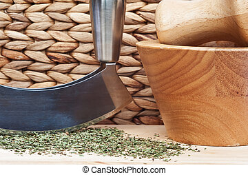 Chopped mint with herb chopper and pestle and mortar -...
