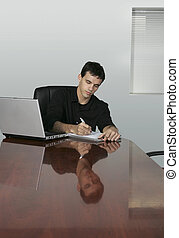 business man in office writing - twenties guy writing at a...