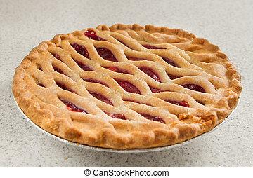cherry pie in a kitchen