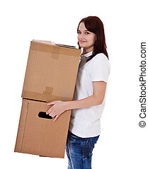 Move - Attractive teenage girl carrying moving boxes All on...
