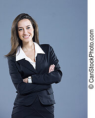 Attractive businesswoman with her arms crossed.