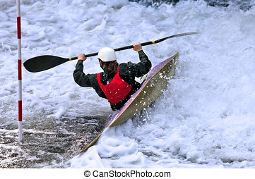 White water kayaker - kayaker negotiating white water from a...