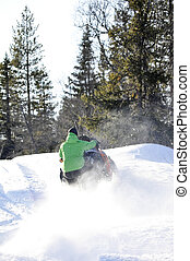 Snowmobile rider in a wintry landscape